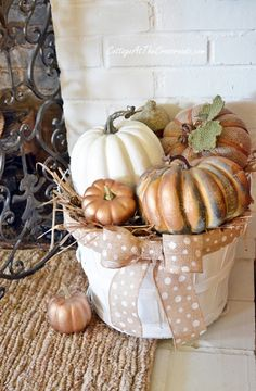 A cheap basket, a little paint and some burlap ribbon make this adorable!