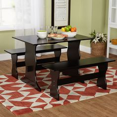 Perfect for a small dining space or kitchen nook, this dining set will complement a variety of decor styles. Chic and simple, this black three-piece table and chair set makes it easy to enjoy a meal with family and friends.