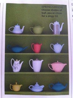 Teapots in alcove shelving