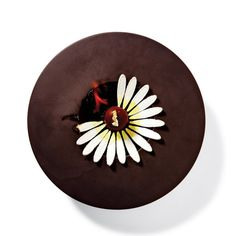 Dominique Ansel's Heartbreak-Inspired Dessert. Rocky-Road ice cream drizzled w/ chocolate, toppedw/ gold leaf w/ chocolate-almond sponge cake underneath.the daisy-like petals are meringues that are ignited & then collapse.