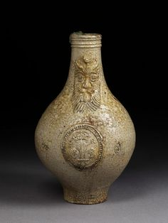 Wine bottle of salt-glazed stoneware, bulbous in form with a narrow neck, and moulded at the mouth, with a small foot, made by John Dwight's Fulham Pottery, Fulham, ca. 1680