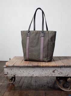 just ordered this SWEET bag from Artifact Bag Co. it's going to my friends to be used as a diaper bag. still trying to figure out how i can justify buying one for myself!!