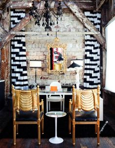 """decor pad """"Chic office with exposed brick wall, white & black geometric curtains, glass-top desk, gold rococo mirror, glossy black lacquer chandelier and Kartell Ghost Chair."""""""