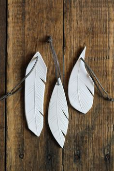 ceramic feather | hanging ornament | white | set of three Still Point Gallery $16 each  Great hostess gift.