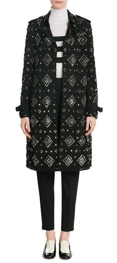 Burberry London and trench coats go hand-in-hand, but the brand is savvy with consistently current iterations of the classic silhouette - case in point is this embellished lace design in classic black. Feminine but tough, you can dress it up or down #Stylebop