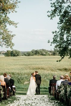 A simple outdoor farm ceremony overlooking a field.