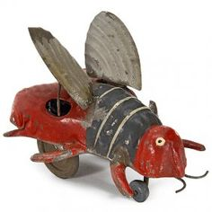 """Günthermann Tin Toy Figure """"Flittering Bee"""" Clockwork-driven, hand-painted tin, moving wings, length 4 in. on May 2014 Metal Toys, Tin Toys, Wood Toys, Toys In The Attic, Bee Art, Vintage Tins, Bees Knees, Antique Toys, Pull Toy"""