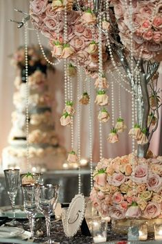 Elegant, vintage wedding decorations with fresh roses and pearls.