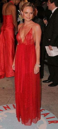 Though the top is slightly too revealing for me, Kate pulls this beautiful red hot dress off.