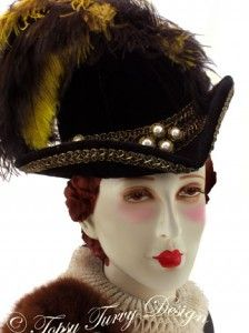 elizabethan hat... I want the peaked V one like this