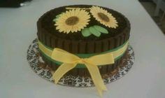 """My version of the KitKat Bar Cake; Ghirardelli Double Chocolate Brownie """"cake"""" layers, Vanilla Bean Ice Cream center, Dark Chocolate KitKat """"barrel"""", crushed Oreos """"dirt"""" topping & home made gum paste flowers. Made for my mother-in-laws Bday celebration...she loves chocolate & sunflowers :) -LV"""