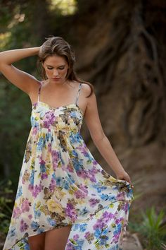 elegant pose with flowy dress, good to remember for summer photo shoot