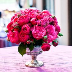 Silver bowls and urns were filled with pink peonies, roses, hydrangeas, lisianthus, tulips, coxcomb and clematis, and placed throughout the room.
