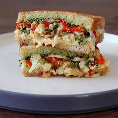 """""""Festive snacks for 1: Roasted cauliflower grilled cheese w/ smoked provolone, house-pickled peppers, collard green-pistachio pesto and roasted garlic…"""""""
