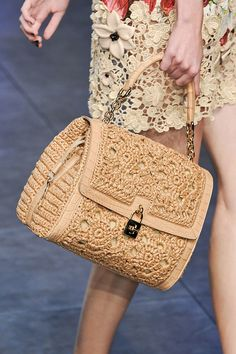 Dolce & Gabbana, Spring 2012 -  you could get this same look, find a vintage bag at the thrift store and find ecru lace and attach.  Instead of hundreds of dollars or thousands.