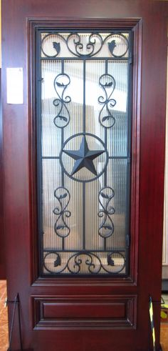 TEXAS STAR IRON GRILL WOOD DOOR | Knotty Alder | Doors for Builders, Inc. | Solid Wood Entry Doors | Exterior Wood Doors | Front Doors | Entry Doors | Mahogany Wood Doors | Mahogany Entry Doors | Home Builders | Home Improvement | Home Remodeling |
