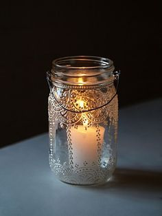 "Mason Jar Lanterns | Hand-decorated mason jar lanterns. So cute with a lit candle inside and hanging on wire across your backyard. Also make beautiful table top decorations.  *5 1/4"" depth"