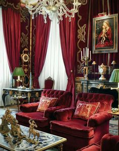 Red sitting room with trimmed walls.