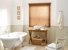 These Oak-look blinds add a warmth to an otherwise neutral minimalist bathroom.