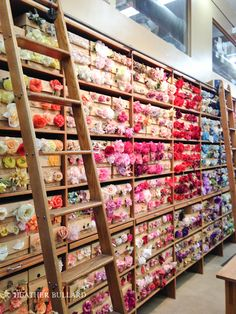 heatherbullard_nyc Tinsel Trading with its trademark wall of vintage millinery flowers