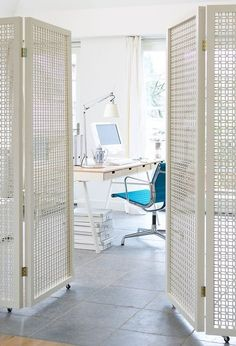 Home Office with DIY White Folding Screen Room Dividers on Wheels  www.apartmenttherapy.com/10-diy-ways-to-divide-small-spaces-202566