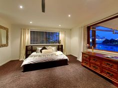 Master suite with waterfront views at HolidayHouseGoldCoast.com