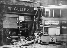 A tram goes off the rails in Woolwich New Road on 26 April It doesn't appear to have deterred the lady from doing her shopping! Image sourced by Steve Hunnisett Vintage London, Old London, East London, Uk History, British History, London Bombings, Transport Pictures, English Architecture, Strange Photos