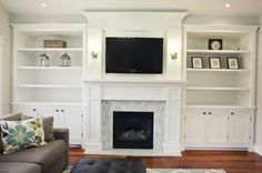 Built-in fireplace surround, elevated crown. I would like to leave the TV space open, not box the size in. The mantle would be amazing, after having nothing but an old fashioned gas heater for our 'fireplace'. The bookshelves if done properly would amazing. The white paint would be okay, better an aged patina, but a wood stained to match our floor would more compliment our look.