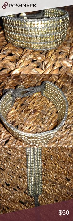 Woven Gold Bead & Black Twine Bracelet Cute gold bead bracelet from jewelry designer Marlyn Schiff. Approximately 7 1/2 inches in length and in excellent condition. Marlyn Schiff Jewelry Bracelets