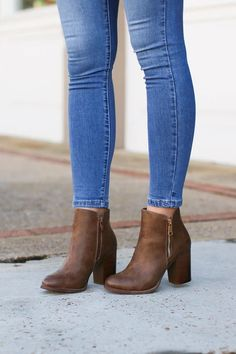 Details We haven't met a pair of booties we didn't like. These classic heeled booties with trendy zipper accent are a must have for your closet! Faux leather Heeled Zipper accent Content Material: Man madeSole: Synthetic Size + Fit  True to size Brown Heeled Boots, Brown Booties, Leather Booties, Leather Heels, Cute Shoes, Me Too Shoes, Bootie Boots, Shoe Boots, Ankle Booties