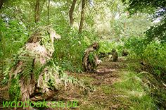 Working as a team with hand signal on a Sniper Experience at Woodoak Wilderness, Surrey, England UK www.woodoak.co.uk