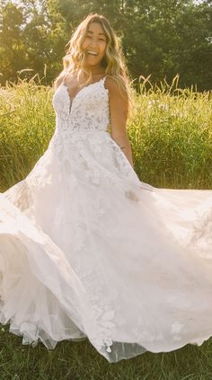 A-line plus size wedding dress style with romantic lace bodice and tulle skirt for the boho bride | Essense of Australia Wedding Dresses Spring 2020 - Belle The Magazine #weddingdress #weddingdresses #bridalgown #bridal #bridalgowns #weddinggown #bridetobe #weddings #bride #dreamdress #bridalcollection #bridaldress #dress See more gorgeous bridal gowns by clicking on the photo