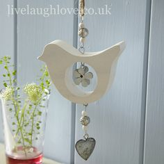A sweet hanging decoration with lots of country style. Wooden bird and hearts with ribbon bow, wooden beads and little silver bell at the end. Height when hanging Wooden Crafts, Diy And Crafts, Shabby Chic Hanging Hearts, Wood Projects, Craft Projects, Shabby Chic Accessories, Butterfly Decorations, Flower Decoration, Wooden Bird