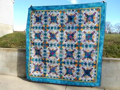 This is Easy Street, Bonnie Hunter's 2012 mystery quilt.  Since I couldn't justify starting any new projects, I worked on this as my leader/ender and traveling project through 2013 and 2014. I finished in time to be on the guest room bed when the kids all came home for Christmas!