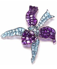 ORCHID BROOCH, Cartier Paris, special order, 1937. White gold, faceted fancy-cut amethysts and aquamarines, pale blue and mauve enamel studs between the stones.