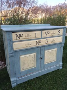 Duck egg blue accented with cream Annie Sloan Chalk paint. Restyled with gentle distressing.