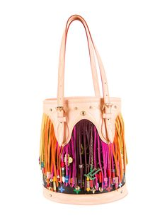 From the Spring/Summer 2006 collection. Limited edition black multicolore monogram coated canvas Louis Vuitton Fringe Bucket Tote with brass hardware, tan vachetta leather trim, multicolor suede fringe and bead embellishment, alcantara lining, interior slip pocket and interior zipped wall pocket. Date code reads SR0046. Includes dust bag. Shop authentic designer handbags by Louis Vuitton at The RealReal.