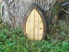 how freaking adorable is this gnome fairy door wish i had a tree or a yard