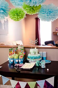 Under the Sea Birthday Party - dessert table, with pom poms, banners, under the sea cake!