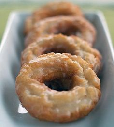 Sour Cream Old-Fashioned Doughnuts with Vanilla Glaze. 2 1/4 cups cake/soft-wheat flour plus more for rolling and cutting  1 1/2 tsp baking powder  1 tsp iodized salt  3/4 tsp ground nutmeg  1/2 cup sugar  2 tbsp shortening/vegetable lard, trans-fat-free preferred  2 large egg yolks  2/3 cup sour cream  canola oil for frying