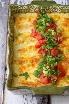 Family friendly 30-minute green chile chicken enchiladas. Make ahead friendly and not too hot for everyone to enjoy. Cheesy goodness.