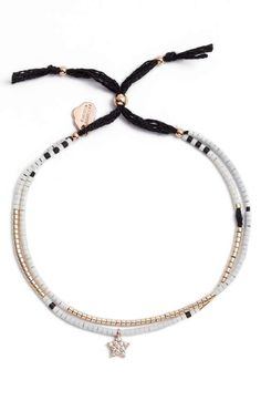 """A twinkling star charm anchors this gift-worthy seed bead bracelet.  9"""" inner circumference; 1/8"""" width Adjustable slide closure Glass/brass. Imported Item #5532500"""
