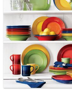 a funky mish-mash of colors, on open shelves in my kitchen. Makes for a happy day.