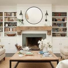 Shiplap on fireplace, rustic mantle, also love the coffee table.
