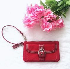"Coach Red Wristlet  Authentic Coach Red Wristlet with the Coach Signature logo. In excellent condition only used a few times!  Interior:  - One main compartment for all your essentials - Brown fabric interior - no stains, rips, damage, etc.  Exterior: - silver buckle design for added style - extra exterior compartment for easy access   Dimensions approx: 7.5"" x 4.5"" x 0.6"" Coach Bags Clutches & Wristlets"