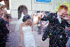 Confetti receiving line...yes please | Austin Wedding at The Blanton Art Museum from Ashley Garmon Photographers  Read more - http://www.stylemepretty.com/texas-weddings/2013/09/04/austin-wedding-at-the-blanton-art-museum-from-ashley-garmon-photograpers/