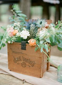 wooden box with florals as rustic centerpiece