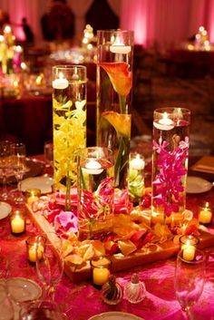 submerged flowers with floating candles! but with pink, purple, and orange? Flower Centerpieces, Wedding Centerpieces, Wedding Table, Wedding Reception, Cylinder Centerpieces, Floral Centrepieces, Indian Reception, Cylinder Vase, Tall Vases