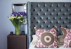 gray wingback tufted headboard; Fahri grape pillow; trunk nightstand; mirror