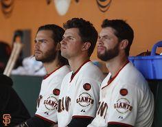 Brandon Crawford, Joe Panik, and Brandon Belt watching from the dugout at AT&T Park